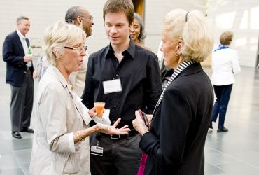 Marilyn Arthur (left) with Chief Curator Trevor Schoonmaker and Anita Schwarz at a member event in 2010. Photo by J Caldwell.