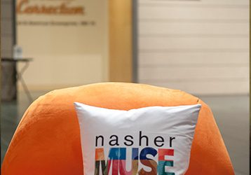 Pillows adorned with the Nasher MUSE logo at an exhibition opening party.