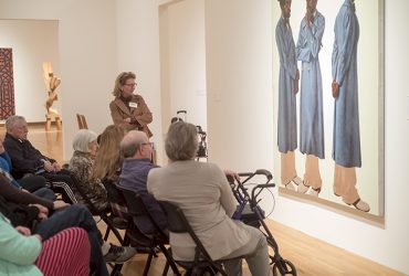 Visitors on a Reflections tour consider a Barkley Henderick's painting. Photo by J Caldwell.