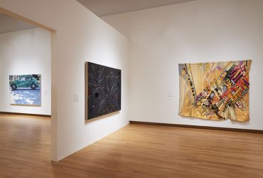 Installation view of Disorderly Conduct, with Sylvia Heyden's Hurricane on the far right and Joan Snyder's This Ancient Tree in the center. Photo by Peter Paul Gioffrion.