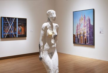 Installation view of Disorderly Conduct. Manuel Neri's sculpture of a female figure in white plaster, On the Up is in the foregro,und and Audrey Flack's Siena Cathedral is on the right. Photo by Peter Paul Gioffrion.