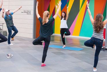 A Nasher intern leads yoga in the Great Hall for other students.