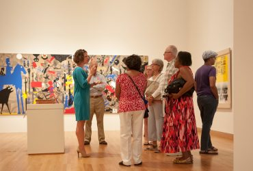 Members on a special exhibition tour with a Nasher Gallery Guide. Photo by J Caldwell.