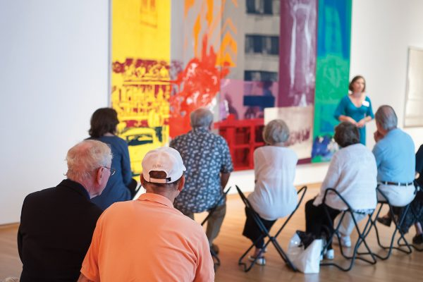 Visitors to the Reflections Program enjoy a gallery visit led by a Nasher Educator.