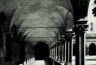 Pietro Todo, Chiostro S. Andrea —scorcio (View of St. Andrea Cloisters), c. 1970. Vintage ferrotyped gelatin silver print, 15 1/2 × 11 1/2 inches (39.4 × 29.2 cm). Collection of Charles and Linda Googe. © Pietro Todo.