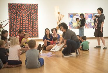 Visitors bring children ages 1 to 5 years for a story read in English and Spanish at the Nasher Museum.