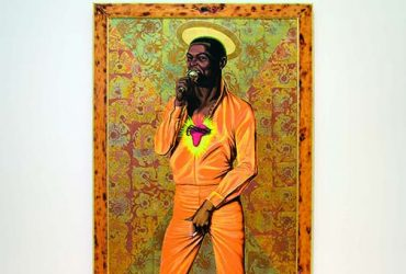 In this portrait of Barkley L. Hendricks, Fela: Amen, Amen, Amen, Amen, a three-quarters portrait of African musician Fela Kuti grabs his crotch and wears a T-shirt with a picture of Africa bleeding with a crown of thorns. Below the portrait, 27 pairs of high heels represent Fela's wives.