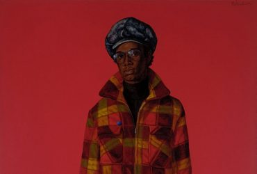 In this portrait by Barkley L. Hendricks, Blood (Donald Formey), a male figure wears a plaid hat, jacket and pants against a bright red background.