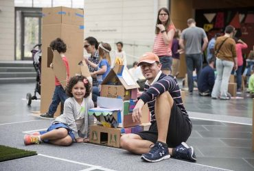 Families build cardboard city at the Nasher Museum as part of Free Family Day.
