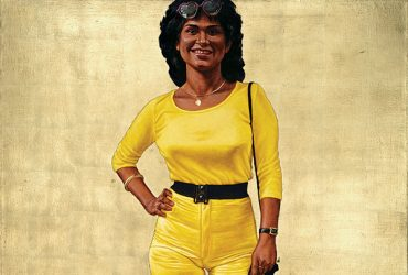 In this portrait, Barkley L. Hendricks, Icon for Fifi, a full-length figure of a woman wearing a yellow top and yellow pants with a black belt stands against a gold leaf background.