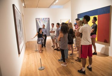 Visitors on a Highlights Tour experience the galleries with a Gallery Guide.