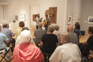 During Reflections Group Tours, visitors often enjoy music in the galleries. Photo by J Caldwell.