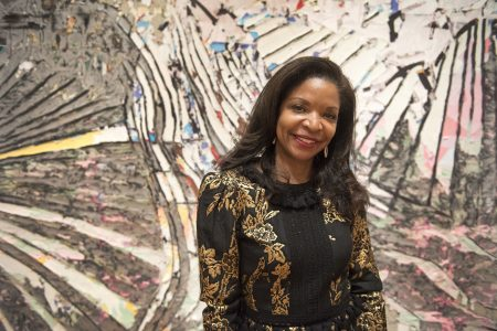 Pamela Joyner poses in front of Mark Bradford's 2014 work, No Time to Expand the Sea. The Pamela J Joyner and Alfred J Giuffrida Collection was started in 1999 and originally focused on abstract work by post-war and contemporary African-American artists. Photo by J Caldwell.
