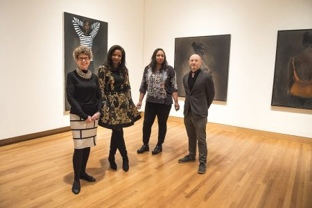 Nasher Museum Director Sarah Schroth (left) poses in the gallery among works by Lynette Yiadom-Boakye with (from left to right) collector Pamela Joyner, artist Shinique Smith and Marshall N. Price, Nancy Hanks Curator of Modern and Contemporary Art. Photo by J Caldwell.