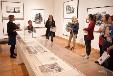 Duke Student discusses the installation of Kara Walker's prints