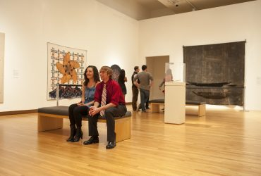 Duke University students look at art from the Nasher Museum's collection during a Muse party