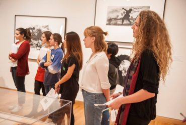 Duke students admire the Installation of Kara Walker's prints