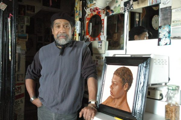 "Barkley L. Hendricks in his home in New London, Conn., in 2007, with ""Frog"" (1976). Credit C.M. Glover for The New York Times"