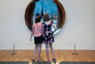 "Area teens look at Anish Kapoor's ""Full Moon"""