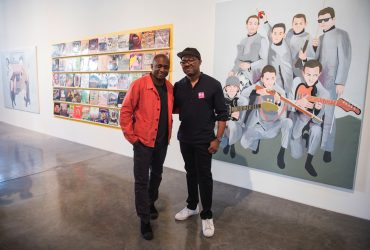 Artist Hank Willis Thomas (left) greets art collector Dr. Kenneth Montague at the Contemporary Arts Center. Photo by J Caldwell.
