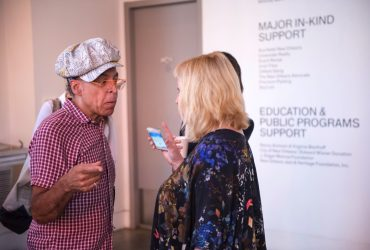 P.4 artist Satch Hoyt chats with a visitor at the Contemporary Arts Center. Photo by J Caldwell.