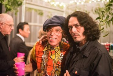 P.4 artist Satch Hoyt (left) enjoys the Swamp Galaxy Gala with Nasher artist William Cordova. Photo by J Caldwell.