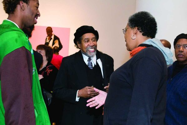 Artist Barkley L. Hendricks (center) talking with Philadelphia Tribune writer Bobbi Booker and her son (left) Benjamen-Hannibal Collins. Photo credit: Linda Johnson. ISOCUAL.