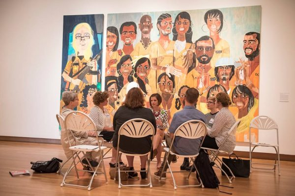 Jessica Ruhle, center, guides a conversation on art at the Nasher Museum as part of the Reflections program.