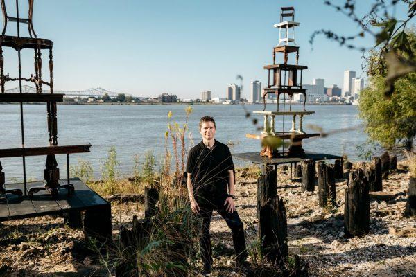 Trevor Schoonmaker near Jennifer Odem's Rising Tables