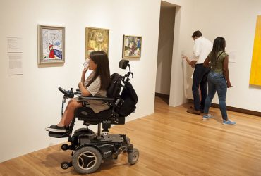 A Duke student takes a close look at several works by Douglas Bourgeois. Photo by J Caldwell.