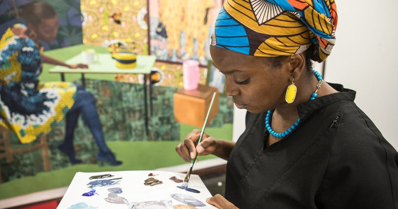 Njideka Akunyili Crosby paints in her Los Angeles studio in September 2017. JOHN D. AND CATHERINE T. MACARTHUR FOUNDATION