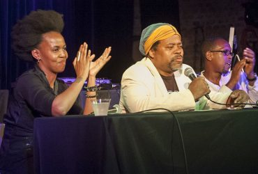 Artist Wangechi Mutu takes part in a conversation with music critic Greg Tate (middle) and Duke Professor Mark Anthony Neal at Motorco Music Hall. Photo by J Caldwell.