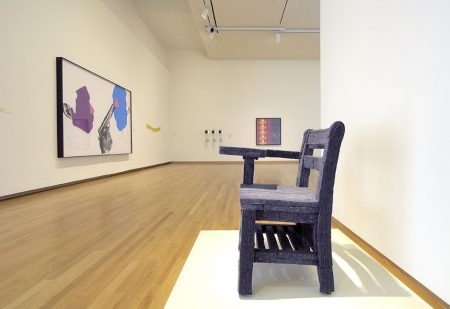 Gallery installation view of Collected Identies, featuring a 1992 sculpture of felt and wood by Gary Simmons, Erasure Chair. Photo by Peter Paul Geoffrion.