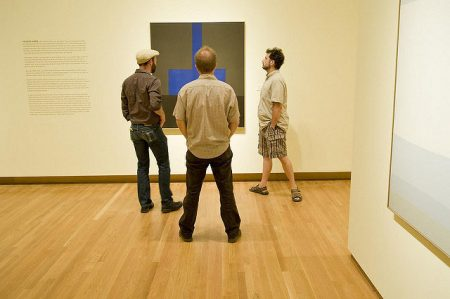 Visitors study a work by contemporary abstractionist Felrath Hines. Photo by J Caldwell.
