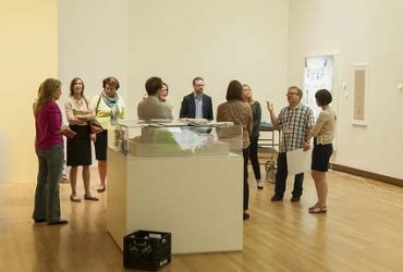 Assistant Curator Katie Adkins (right), who coordinated Doris Duke's Shangri La for the Nasher Museum, with Exhibition Designer Brad Johnson (second from right) leads a tour of Brummer Society members in advance of the exhibition opening. Photo by J Caldwell.