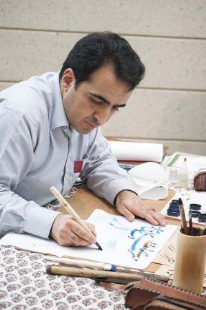 Calligrapher Mohamed Zakariya gives a demonstration