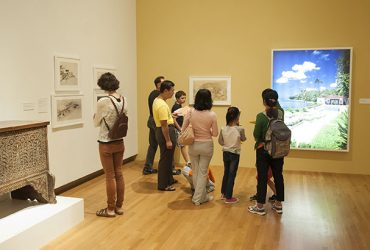 Visitors enjoy the exhibition during a Free Family Day event. Photo by J Caldwell.