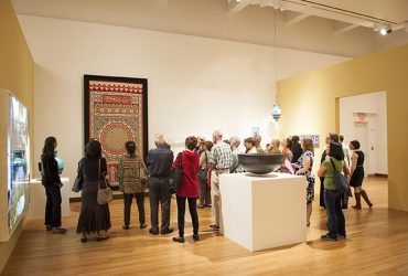 Visitors take part in a gallery tour. Photo by J Caldwell.