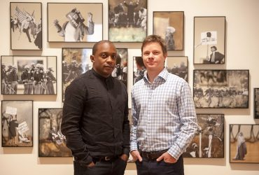 Artist Hank Willis Thomas (left) with Chief Curator Trevor Schoonmaker. Photo by J Caldwell.