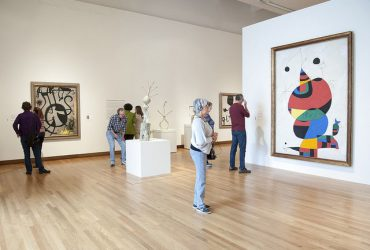 Visitors pause in the entrance gallery of Miro: The Experience of Seeing. Photo by J Caldwell.