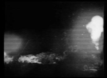 A still from the video shows murky explosions.