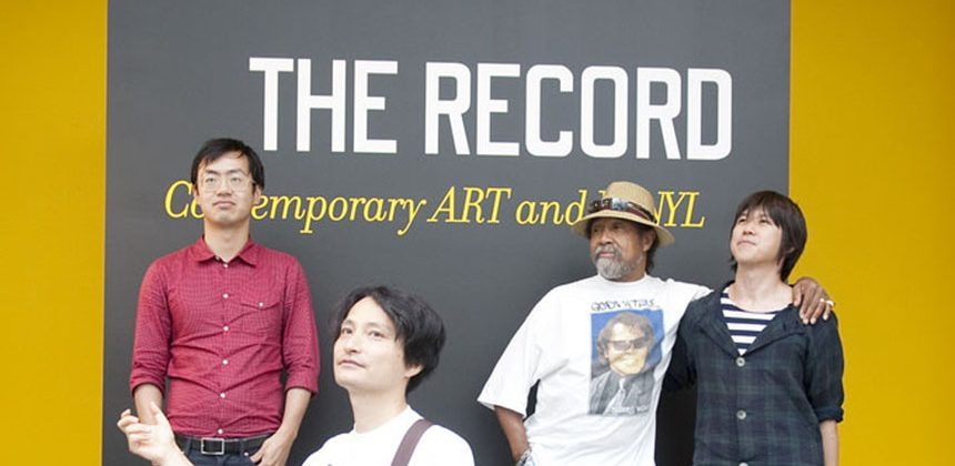 Visiting artists (from left) Tim Lee (Vancouver), Taiyo Kimura (Japan), Barkley L. Hendricks (Connecticut) and Lyota Yagi (Japan) strike a pose inspired by record album covers at the entrance wall of The Record. Photo by J Caldwell.