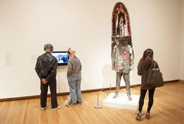 Visitors enjoy All Matterings of Mind, watching a video about artist Nick Cave and taking a closer look at his work, Soundsuit.