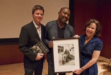 Curator Trevor Schoonmaker (left) accepts the gift of a photograph from Dr. Kenneth Montague with Nasher Museum Director Kim Rorschach. Photo by J Caldwell.