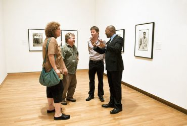 Collector Dr. Kenneth Montague (right) chats in the gallery with (from left) Susan Hendricks, Exhibition Designer Brad Johnson and Chief Curator Trevor Schoonmaker. Photo by J Caldwell.