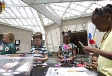 Young visitors make mobiles and stabiles inspired by Calder at a Family Day event. Photo by J Caldwell.