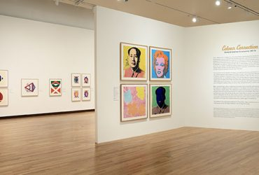 Installation view of Colour Correction: British and American Screenprints, 1967-75 . The entrance wall features four prints by Andy Warhol, including two Mau Tse Tung prints, a Marilyn Monroe print and a print of flowers.