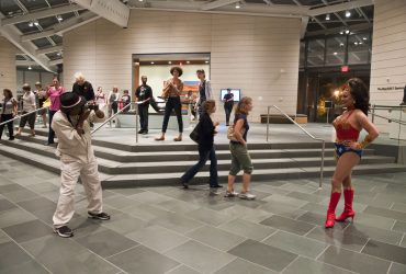 Wonder Woman socializes with visitors during an Art for All event at the Nasher Museum. Photo by J Caldwell.
