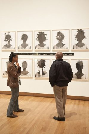 Visitors stroll the galleries within The Deconstructive Impulse. Photo by J Caldwell.