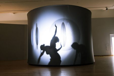 Dancers move within the sculpture. Photo by J Caldwell.